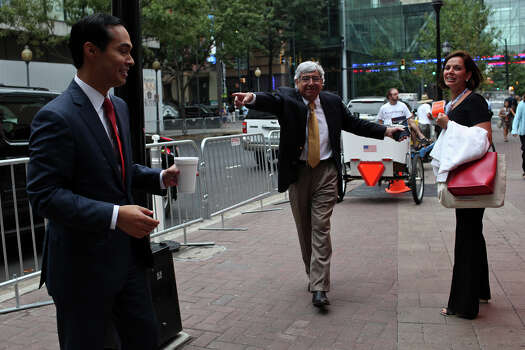 Tony Martinez, the Mayor of Brownsville, center, calls to Mayor Julian Castro after passing him on the street the morning after his keynote speech during the Democratic National Convention in Charlotte, NC on Wednesday, Sept. 5, 2012. Photo: Lisa Krantz, San Antonio Express-News / San Antonio Express-News