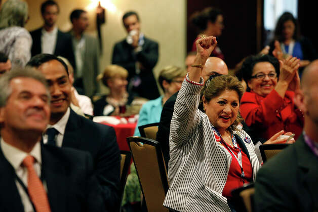 "Nancy Garcia, of San Antonio, right, and Choco Meza, of San Antonio, far right, cheer for Mayor Julian Castro as he speaks the morning after his keynote speech during ""A Texas Leadership Salute"" at the Omni Hotel during the Democratic National Convention in Charlotte, NC on Wednesday, Sept. 5, 2012. At left, is the mayor's brother, Joaquin Castro. Photo: Lisa Krantz, San Antonio Express-News / San Antonio Express-News"