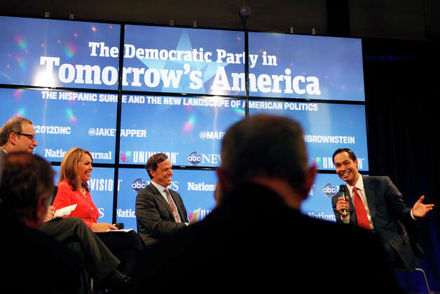 "Mayor Julian Castro, right, participates in a panel entitled ""The Democratic Party in Tomorrow's America: The Hispanic Surge and the New Landscape of American Politics,"" hosted by Ron Brownstein of the National Journal, from left, Maria Elena Salinas from Univision and Jake Tapper of ABC News, the morning after his keynote speech during the Democratic National Convention in Charlotte, NC on Wednesday, Sept. 5, 2012. Photo: Lisa Krantz, San Antonio Express-News / San Antonio Express-News"