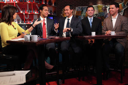 Mayor Julian Castro, left, and his brother, Joaquin Castro, joke about how to tell them apart by who has a wedding ring, during their interview on CNN's morning news program Starting Point with anchor Soledad O'Brien, left, at the CNN Grill during the Democratic National Convention in Charlotte, NC on Wednesday, Sept. 5, 2012. Photo: Lisa Krantz, San Antonio Express-News / San Antonio Express-News