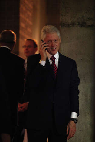 Former President Bill Clinton talks on the phone as he leaves his party during the Democratic National Convention in Charlotte, NC on Wednesday, Sept. 5, 2012. Photo: Lisa Krantz, San Antonio Express-News / San Antonio Express-News
