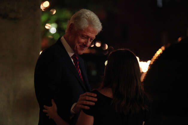 "Former President Bill Clinton talks with Gabrielle Pfafflin, 21, of Austin, as he leaves his party during the Democratic National Convention in Charlotte, NC on Wednesday, Sept. 5, 2012. ""It's been my lifelong dream to meet him,"" Pfafflin said after waiting on the street for the opportunity. Pfafflin said her father worked for Clinton. Photo: Lisa Krantz, San Antonio Express-News / San Antonio Express-News"