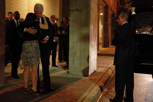 "Former President Bill Clinton is embraced by Gabrielle Pfafflin, 21, of Austin, as he leaves his party during the Democratic National Convention in Charlotte, NC on Wednesday, Sept. 5, 2012. ""It's been my lifelong dream to meet him,"" Pfafflin said after waiting on the street for the opportunity. Pfafflin said her father worked for Clinton. Photo: Lisa Krantz, San Antonio Express-News / San Antonio Express-News"