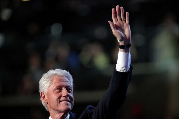 Former President Bill Clinton walks onstage to deliver his speech during the Democratic National Convention at Time Warner Cable Arena in Charlotte, NC on Wednesday, Sept. 5, 2012. Photo: Lisa Krantz, San Antonio Express-News / San Antonio Express-News