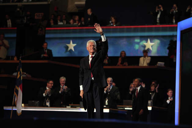 Former President Bill Clinton waves after speaking as he waits for President Barack Obama to come onstage during the Democratic National Convention at Time Warner Cable Arena in Charlotte, NC on Wednesday, Sept. 5, 2012. Photo: Lisa Krantz, San Antonio Express-News / San Antonio Express-News