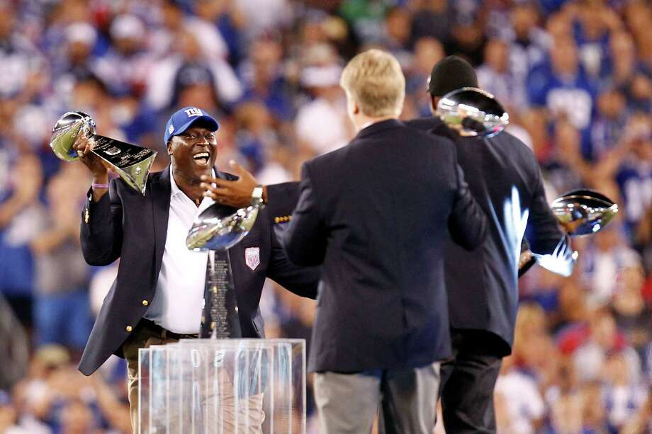 EAST RUTHERFORD, NJ - SEPTEMBER 05:  (L-R) Former New York Giants Otis Anderson, Michael Strahan and Phill Simms take part in a pregame cermony prior to the 2012 NFL season opener between the New York Giants and the Dallas Cowboys at MetLife Stadium on September 5, 2012 in East Rutherford, New Jersey. Photo: Jeff Zelevansky, Getty Images / 2012 Getty Images