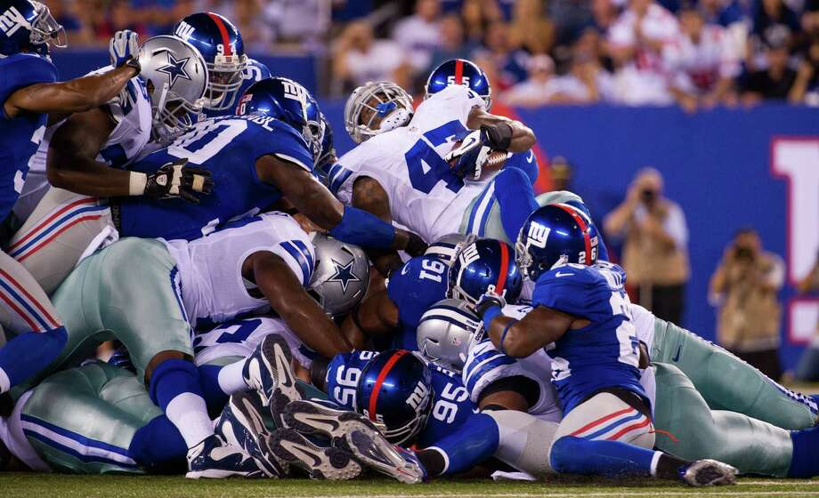 New York Giants stop Dallas Cowboys running back Lawrence Vickers (47) on 4th down in the 1st half. New York Giants against the Dallas Cowboys at MetLife Stadium. Photo: Ron Antonelli, New York Daily News / 2012/Daily News, L.P. (New York)