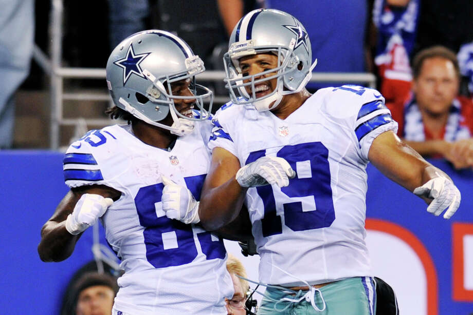 Dallas Cowboys wide receivers Miles Austin (19) and Kevin Ogletree (85) celebrate Ogletree's touchdown during the first half of an NFL football game against the New York Giants, Wednesday, Sept. 5, 2012, in East Rutherford, N.J. The Cowboys won 24-17. Photo: Bill Kostroun, AP / FR59151 AP