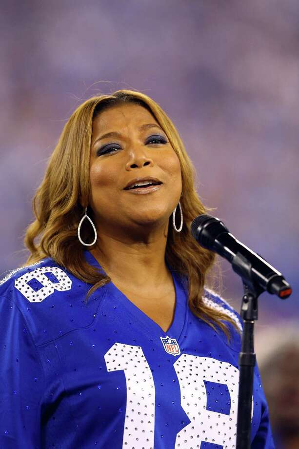 EAST RUTHERFORD, NJ - SEPTEMBER 05:  Queen Latifah performs the national anthen prior to the 2012 NFL season opener between the New York Giants and the Dallas Cowboys on September 5, 2012 in East Rutherford, New Jersey. Photo: Al Bello, Getty Images / 2012 Getty Images