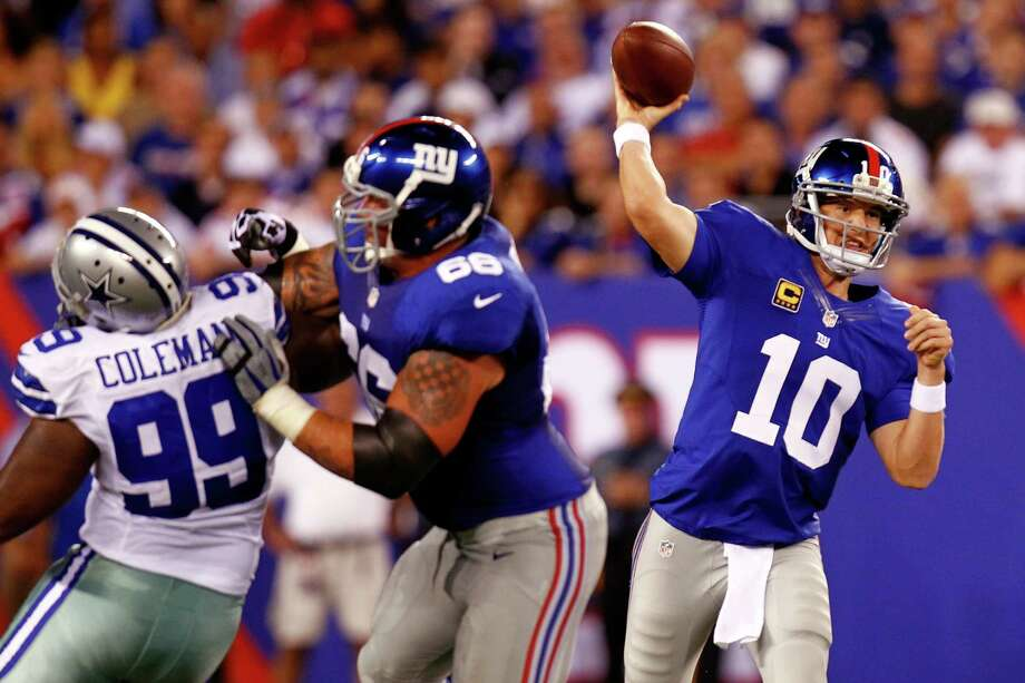 EAST RUTHERFORD, NJ - SEPTEMBER 05:  Quarterback Eli Manning #10 of the New York Giants drops back to pass against the Dallas Cowboys during the 2012 NFL season opener at MetLife Stadium on September 5, 2012 in East Rutherford, New Jersey. Photo: Jeff Zelevansky, Getty Images / 2012 Getty Images