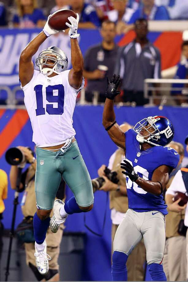 EAST RUTHERFORD, NJ - SEPTEMBER 05:  wide receiver Miles Austin #19 of the Dallas Cowboys catches a ball on his way to scoring a touchdown in the fourth quarter against defensive back Justin Tryon #30 of the New York Giants during the 2012 NFL season opener at MetLife Stadium on September 5, 2012 in East Rutherford, New Jersey. Photo: Al Bello, Getty Images / 2012 Getty Images