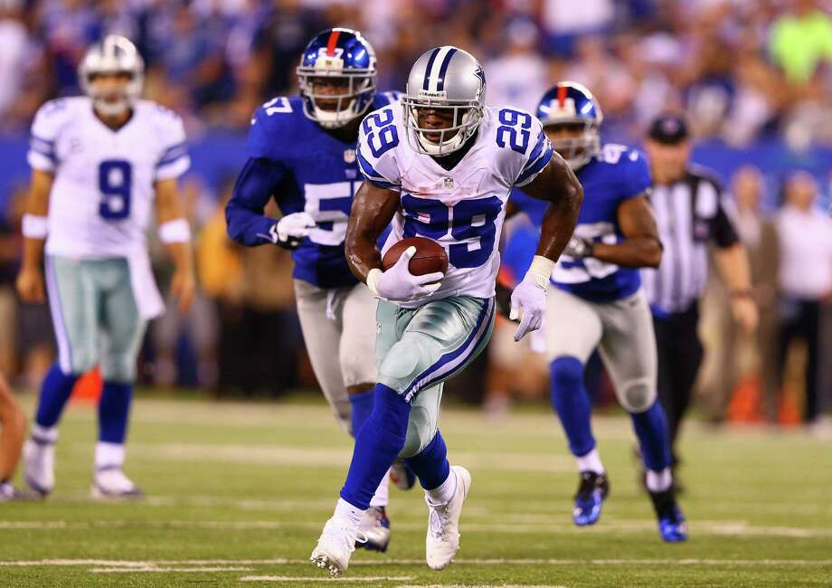 EAST RUTHERFORD, NJ - SEPTEMBER 05: Running back DeMarco Murray #29 of the Dallas Cowboys runs with the ball against the New York Giants during the 2012 NFL season opener at MetLife Stadium on September 5, 2012 in East Rutherford, New Jersey. Photo: Al Bello, Getty Images / 2012 Getty Images