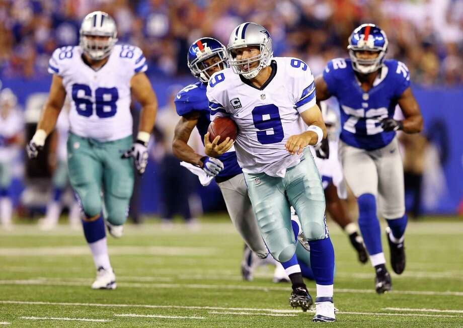EAST RUTHERFORD, NJ - SEPTEMBER 05:  Quarterback Tony Romo #9 of the Dallas Cowboys runs with the ball against the New York Giants during the 2012 NFL season opener at MetLife Stadium on September 5, 2012 in East Rutherford, New Jersey. Photo: Al Bello, Getty Images / 2012 Getty Images