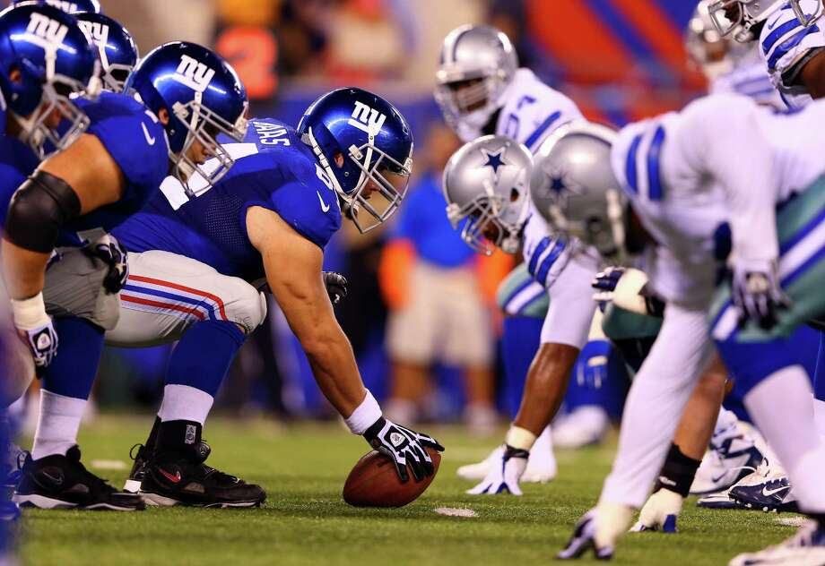EAST RUTHERFORD, NJ - SEPTEMBER 05:  Center David Baas #64 of the New York Giants lines up under center against the Dallas Cowboys during the 2012 NFL season opener at MetLife Stadium on September 5, 2012 in East Rutherford, New Jersey. Photo: Al Bello, Getty Images / 2012 Getty Images