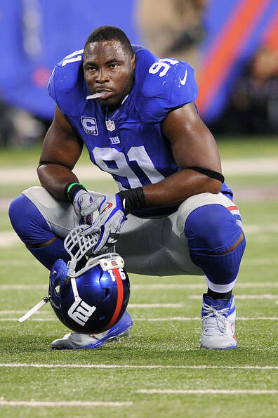 New York Giants defensive end Justin Tuck (91) reacts during the second half of an NFL football game