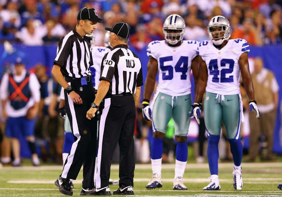 EAST RUTHERFORD, NJ - SEPTEMBER 05:  Back judge Larry Babcock talks with referee Jim Core during the 2012 NFL season opener between the New York Giants and the Dallas Cowboys at MetLife Stadium on September 5, 2012 in East Rutherford, New Jersey. Photo: Al Bello, Getty Images / 2012 Getty Images