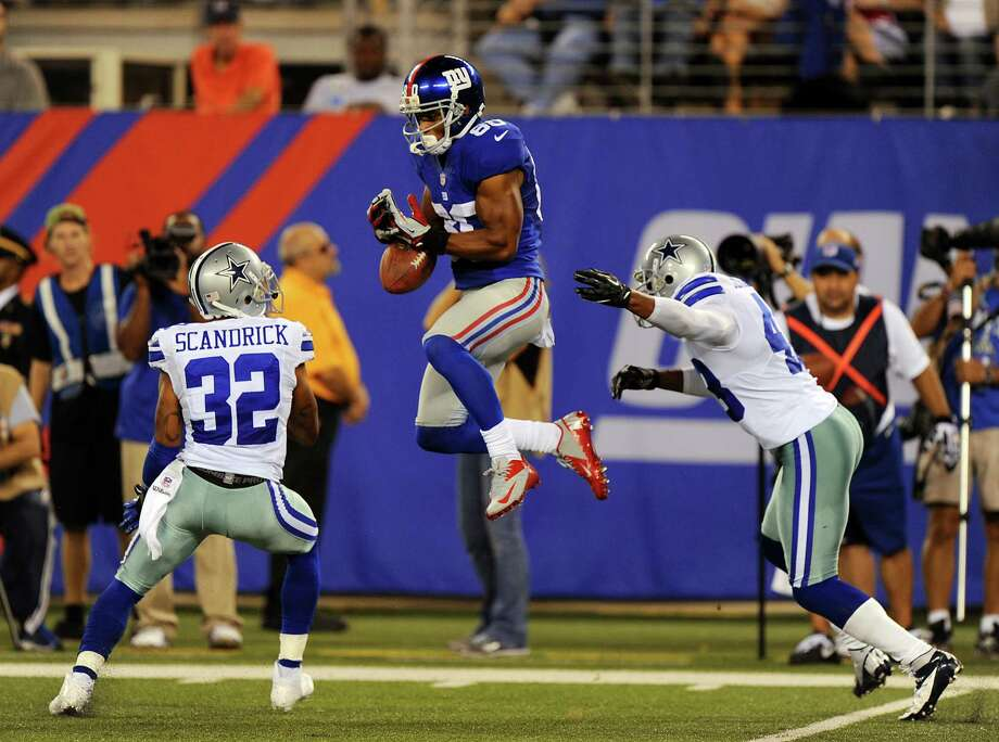 New York Giants wide receiver Victor Cruz #80 drops the ball on a long yardage pass during the second half when the New York Jets played the Dallas Cowboys  Wednesday, September 5, 2012  at the MetLife Stadium in East Rutherford, New Jersey. New York Giants lost 24-17. Photo: Robert Sabo, New York Daily News / 2012/Daily News, L.P. (New York)