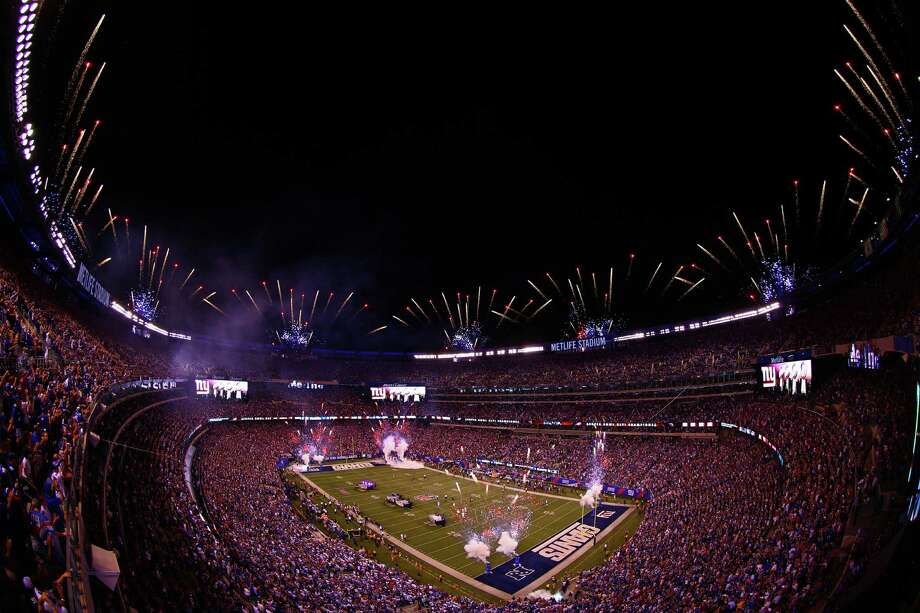 EAST RUTHERFORD, NJ - SEPTEMBER 05:  Fireworks go of atop MetLife Stadium prior to the 2012 NFL season opener between the New York Giants and the Dallas Cowboys on September 5, 2012 in East Rutherford, New Jersey. Photo: Michael Heiman, Getty Images / 2012 Getty Images