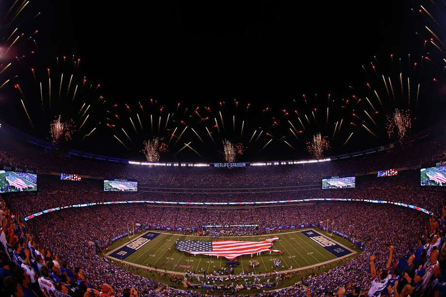 EAST RUTHERFORD, NJ - SEPTEMBER 05:  Fireworks go of atop MetLife Stadium as Queen Latifah performs the national antehn prior to the 2012 NFL season opener between the New York Giants and the Dallas Cowboys on September 5, 2012 in East Rutherford, New Jersey. Photo: Michael Heiman, Getty Images / 2012 Getty Images