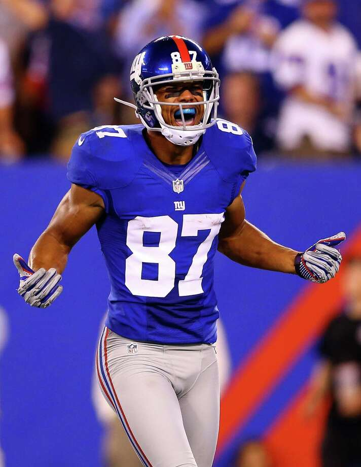 EAST RUTHERFORD, NJ - SEPTEMBER 05:  wide receiver Domenik Hixon #87 of the New York Giants reacts after a catch in the third quarter against the Dallas Cowboys during the 2012 NFL season opener at MetLife Stadium on September 5, 2012 in East Rutherford, New Jersey. Photo: Al Bello, Getty Images / 2012 Getty Images