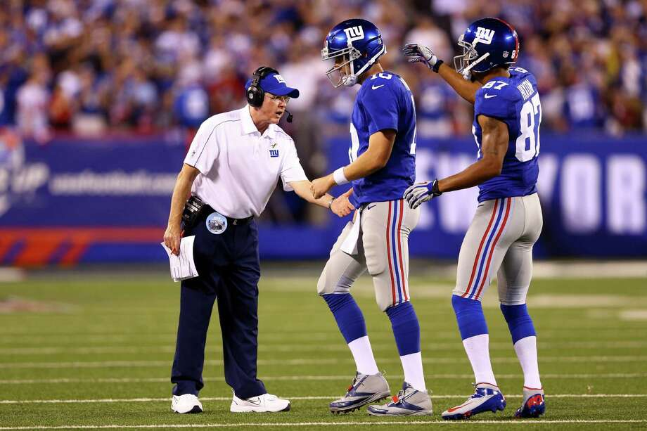 EAST RUTHERFORD, NJ - SEPTEMBER 05:  Head coach Tom Coughlin of the New York Giants greets quarterback Eli Manning #10 and wide receiver Domenik Hixon #87 after a touchdown in the third quarter in the third quarter against the Dallas Cowboys during the 2012 NFL season opener at MetLife Stadium on September 5, 2012 in East Rutherford, New Jersey. Photo: Al Bello, Getty Images / 2012 Getty Images