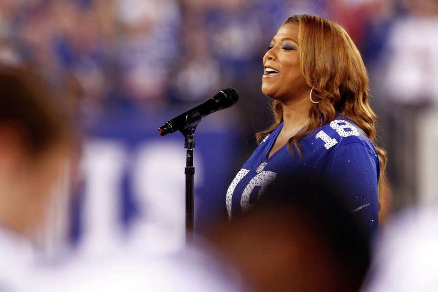 EAST RUTHERFORD, NJ - SEPTEMBER 05:  Queen Latifah performs the national anthen prior to the 2012 NF