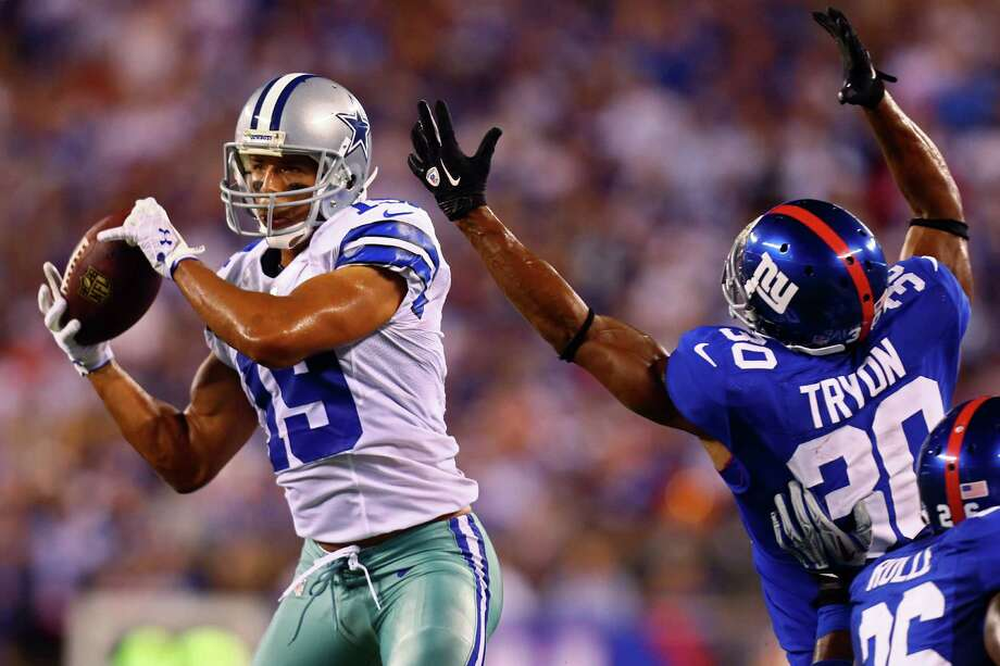 EAST RUTHERFORD, NJ - SEPTEMBER 05:  wide receiver Miles Austin #19 of the Dallas Cowboys catches a ball on his way to scoring a touchdown in the fourth quarter against defensive back Justin Tryon #30 of the New York Giants during the 2012 NFL season opener at MetLife Stadium on September 5, 2012 in East Rutherford, New Jersey. Photo: Jeff Zelevansky, Getty Images / 2012 Getty Images