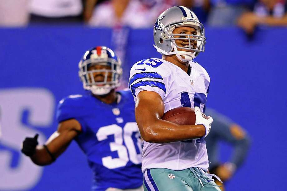 EAST RUTHERFORD, NJ - SEPTEMBER 05:  wide receiver Miles Austin #19 of the Dallas Cowboys reacts after scoring a touchdown in the fourth quarter against defensive back Justin Tryon #30 of the New York Giants during the 2012 NFL season opener at MetLife Stadium on September 5, 2012 in East Rutherford, New Jersey. Photo: Al Bello, Getty Images / 2012 Getty Images