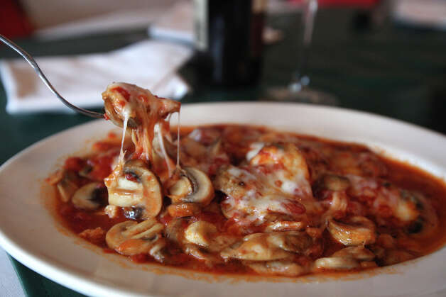 The Fungui grattinati are sauteed mushrooms with garlic, tomato sauce and cheese, at Piccolo's Italian Ristorante located at 5703 Evers Road, Tuesday, Sept. 3, 2012. Photo: Jerry Lara, San Antonio Express-News / © 2012 San Antonio Express-News