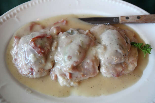 The saltimbocca (veal with ham, spinach and a bit of cheese) at Piccolo's Italian Ristorante. Photo: Jerry Lara, San Antonio Express-News / © 2012 San Antonio Express-News