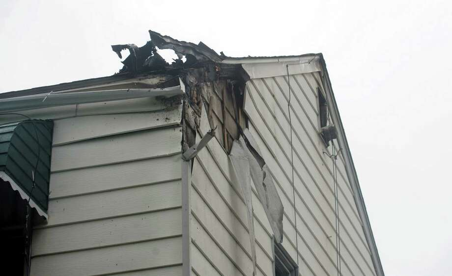 The house at 62 Wilson Street in Stamford is damaged after a fire in the attic early Thursday morning on September 6, 2012. Photo: Lindsay Niegelberg / Stamford Advocate