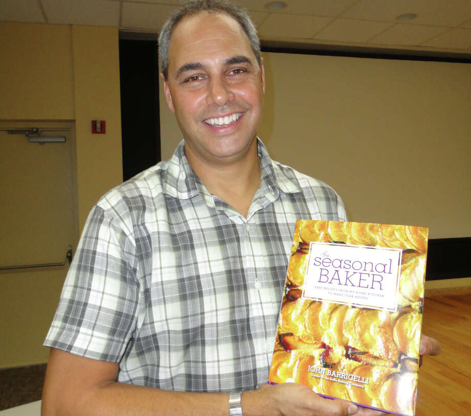 """John Barricelli, owner of the SoNo Baking Company and Cafe in Norwalk and Westport, introduced his second cookbook, """"The Seasonal Baker,"""" to about 40 people at the Westport Public Library on Wednesday. Photo: Meg Barone / Westport News freelance"""