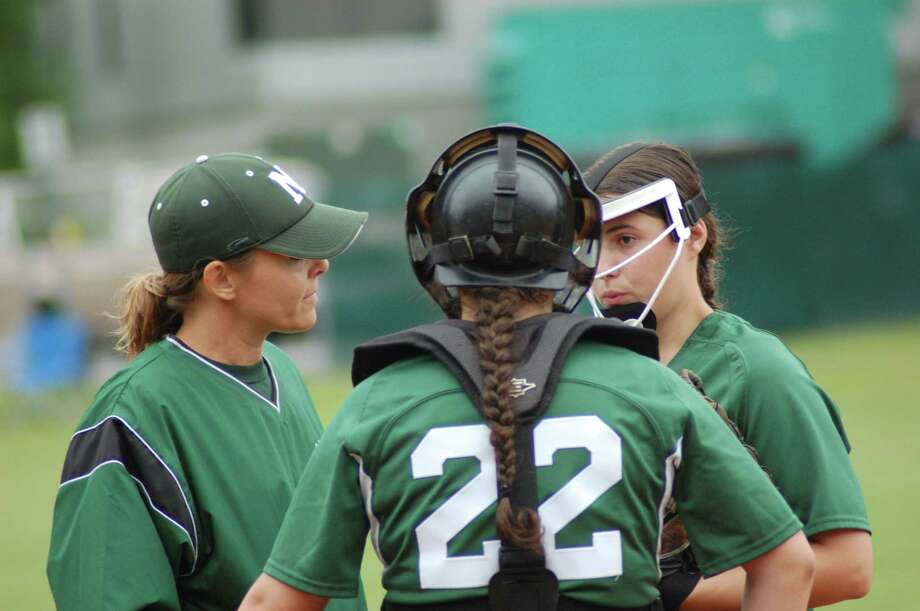 Norwalk head coach Elaine Gratrix meets in the pitcher's circle with pitcher Patti Sciglimpaglia, back, and catcher Mary Sciglimpaglia during a 4-2 win over Fairfield Ludlowe in the FCIAC softball quarterfinals on Thursday May 24, 2012 at Ray Barry Field in Norwalk. Photo: Doug Bonjour