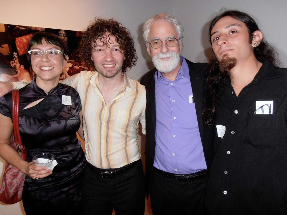 Julia Barbosa, from left, photographer Adad Hannah, SAMA s David Rubin and artist Raul Castellanos celebrate the opening of Hannah s exhibition at the San Antonio Museum of Art. Photo: San Antonio Express-News