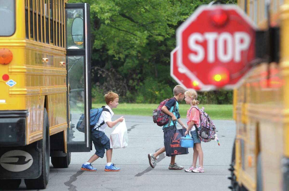 AW Becker Elementary School students get off their bus and head into the school on their first day back on Thursday, Sept. 6, 2012 in Selkirk, NY. (Paul Buckowski / Times Union)