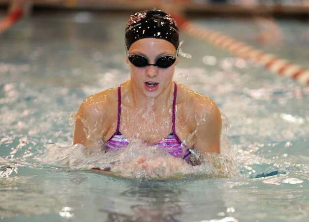 Katie Evans, a junior, of the Greenwich High School girls swimming team, practices the breathstroke Wednesday, Sept. 5, 2012. Photo: Helen Neafsey / Greenwich Time