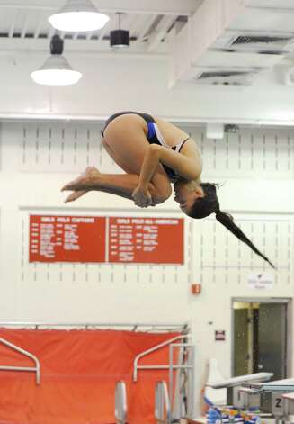 Weronika Filarska, a senior, of the Greenwich High School girls dive team, Wednesday, Sept. 5, 2012. Photo: Helen Neafsey / Greenwich Time