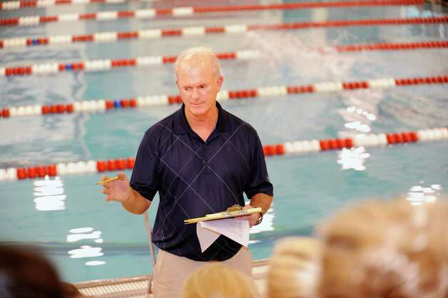 Coach Dick Hawks speaks to the Greenwich High School girls swimming team at at a practice Wednesday, Sept. 5, 2012. Photo: Helen Neafsey / Greenwich Time