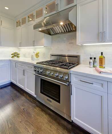 A closer look at the cabinetry and marble finishes in the kitchen. Photo: Dan Friedman