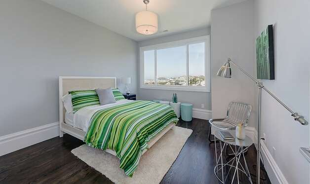 A bedroom boasts scenic city views from its window. Photo: Dan Friedman
