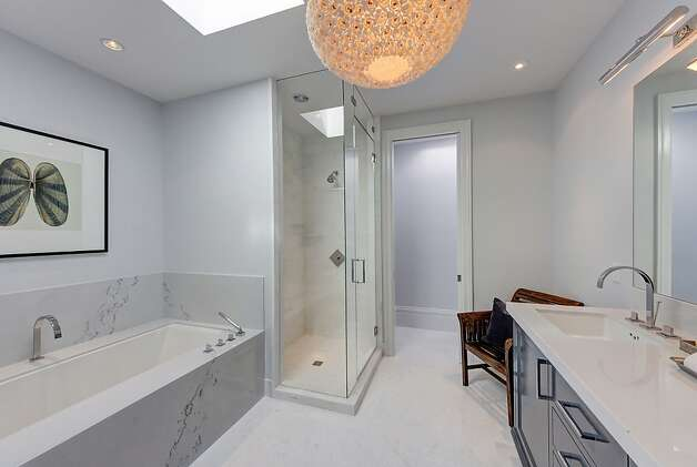 The master suite delivers a spa-like marble bathroom. Photo: Dan Friedman