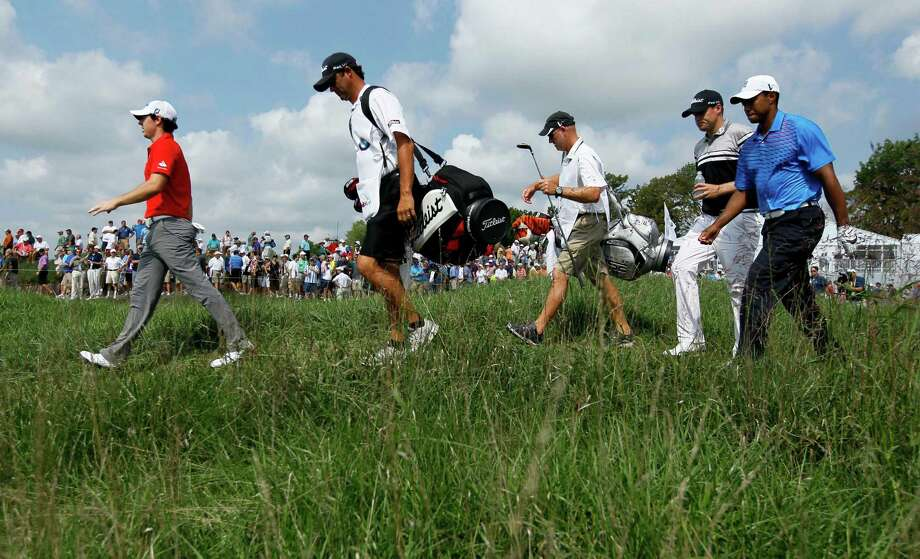 The threesome of  Rory McIlroy, left, of Northern Ireland, Tiger Woods, right and  Nick Watney, second from right head out on the 10th fairway during the first round of the BMW Championship PGA golf tournament at Crooked Stick Golf Club in Carmel, Ind., Thursday, Sept. 6, 2012. (AP Photo/Charles Rex Arbogast) Photo: Charles Rex Arbogast, Associated Press / AP