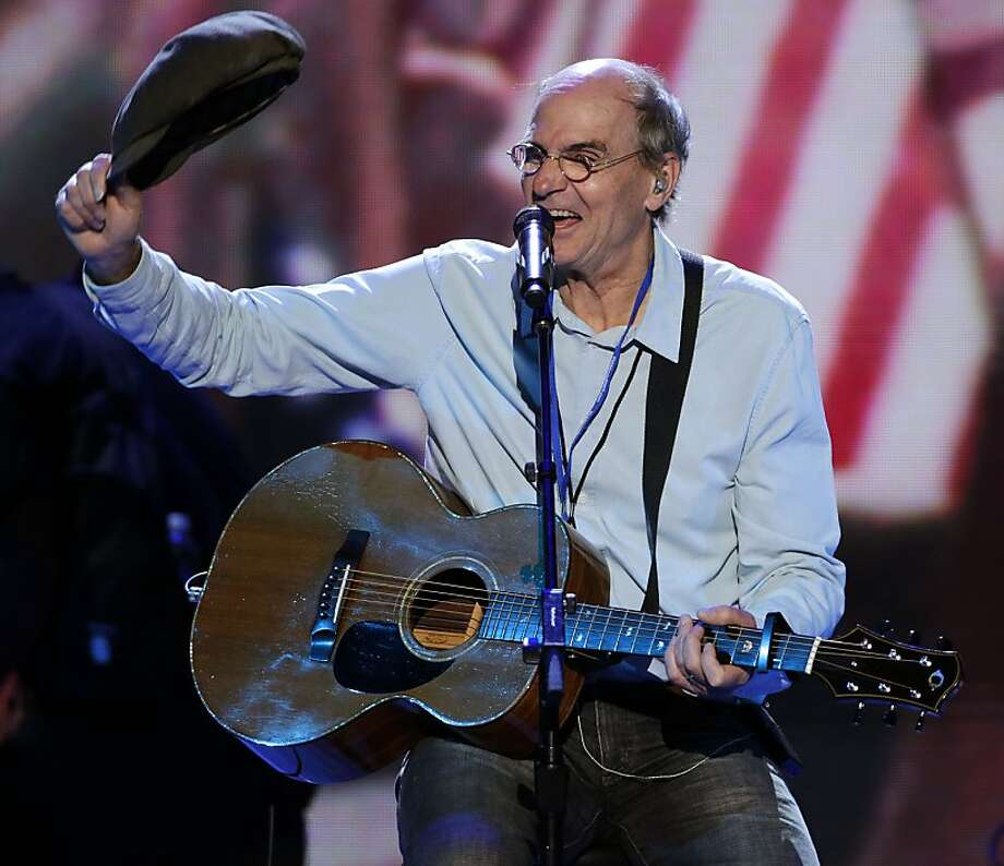 Singer songwriter James Taylor waves his hat towards fans after a sound check at the Democratic National Convention in Charlotte, N.C., on Thursday, Sept. 6, 2012. Photo: J. Scott Applewhite, Associated Press