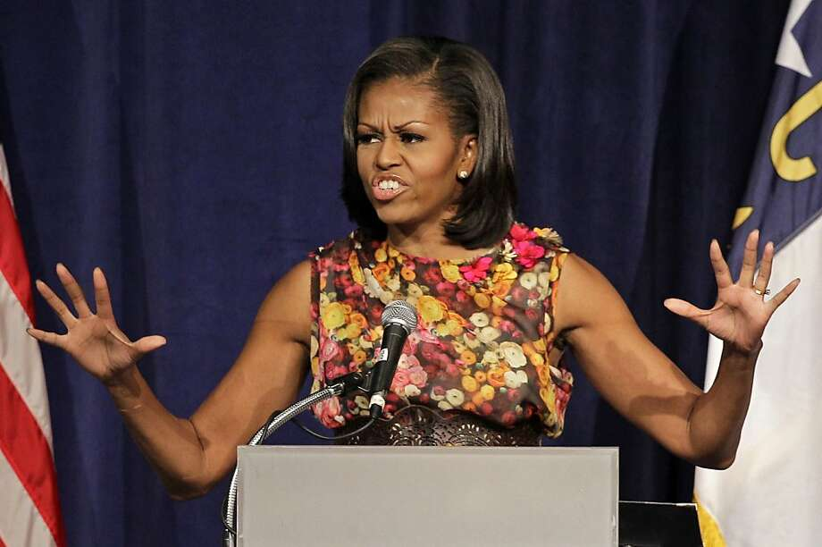 First lady Michelle Obama speaks to the Democrats Women's Caucus during the Democratic National Convention in Charlotte, N.C., Thursday, Sept. 6, 2012. Photo: Chuck Burton, Associated Press