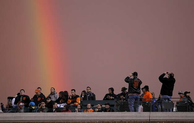 Giants fans turn to photograph  double rainbow that delighted spectators as the San Francisco Giants played the Arizona Diamondbacks at AT&T Park in San Francisco, Calif., on Wednesday, September 5, 2012. Photo: Carlos Avila Gonzalez, The Chronicle