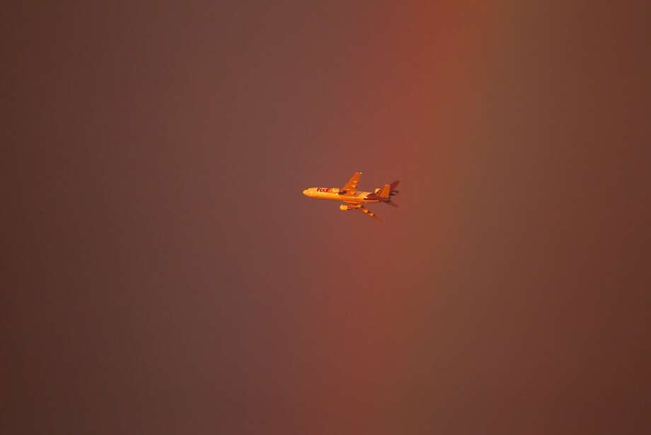 Call it a package deal - a FedEx plane appearing to zoom through the rainbow. Photo: Carlos Avila Gonzalez, The Chronicle