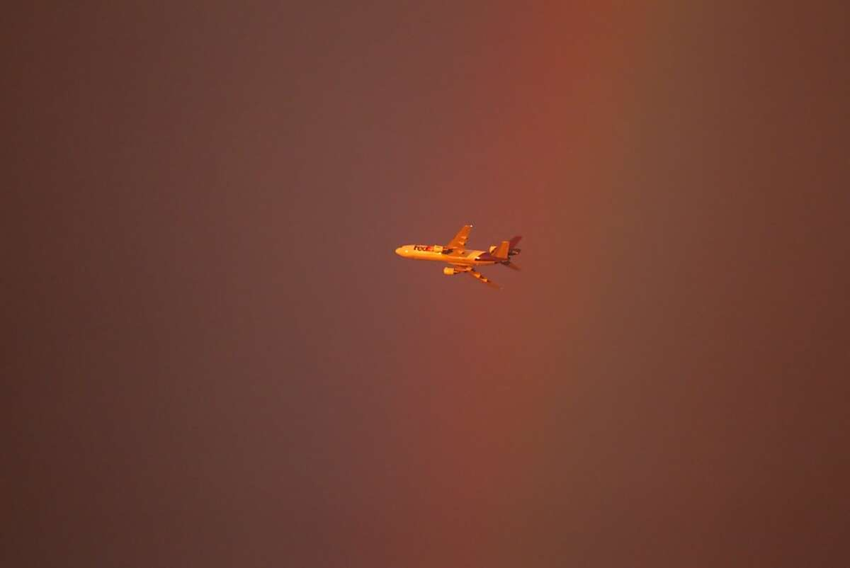 A Fedex plane flies through a double rainbow that delighted spectators as the San Francisco Giants played the Arizona Diamondbacks at AT&T Park in San Francisco, Calif., on Wednesday, September 5, 2012.