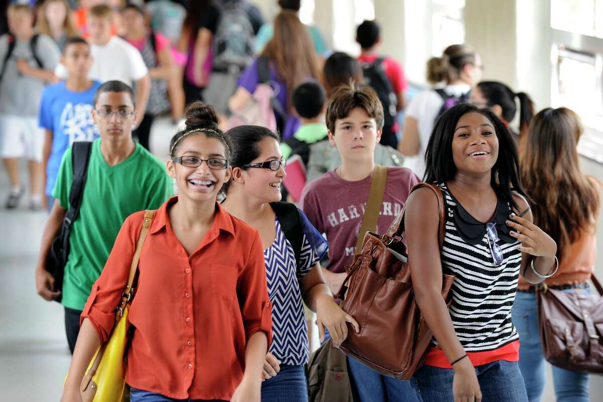 Students at Danbury High School fill the hallways as they change classes Thursday, Sept. 6, 2012.