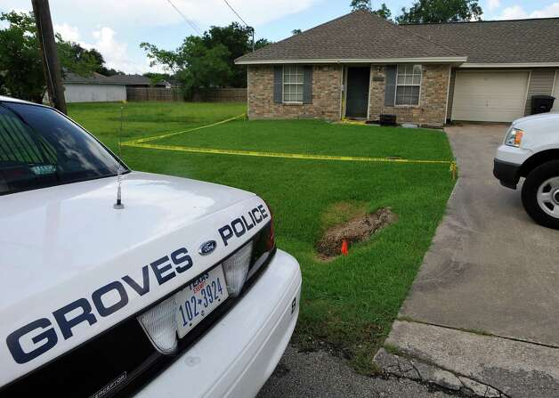 Investigators were still working the crime scene Tuesday morning at this home in Groves at 3131 Cleveland, near Val Street in Groves. John Mason Broadway was arrested early Tuesday in connection with the shooting.  Dave Ryan/The Enterprise