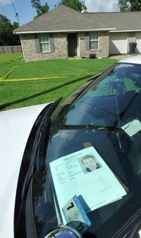 A printout of the suspect was on the dashboard of one of the police cars parked outside where Investigators were still working the crime scene Tuesday morning at this home in Groves at 3131 Cleveland, near Val Street in Groves. John Mason Broadway was arrested early Tuesday in connection with the shooting.  Dave Ryan/The Enterprise